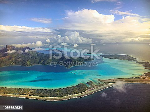 Flying above the atoll of Bora Bora. French Polynesia, South Pacific Ocean.
