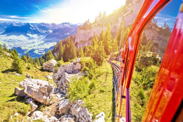 mount pilatus descent on worlds steepest cogwheel railway, tourist landscape of switzerland - lucerne stock pictures, royalty-free photos & images