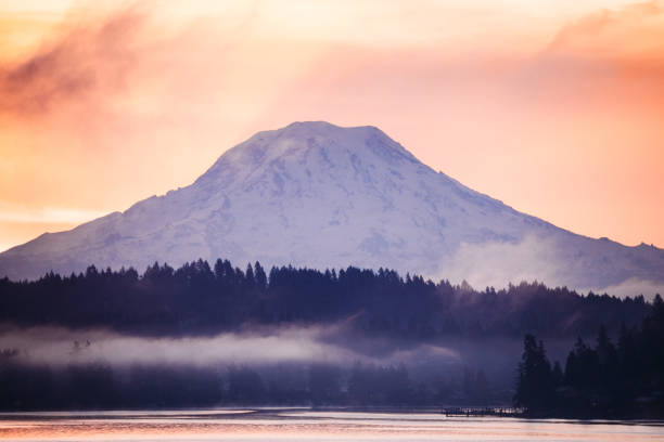 Mount Rainier and Puget Sound at Sunrise A view from the Key Peninsula looking out over the Puget Sound toward Gig Harbor, Washington.  Mount Rainer looms large in the background, contrasted by the rising sun. gig harbor stock pictures, royalty-free photos & images
