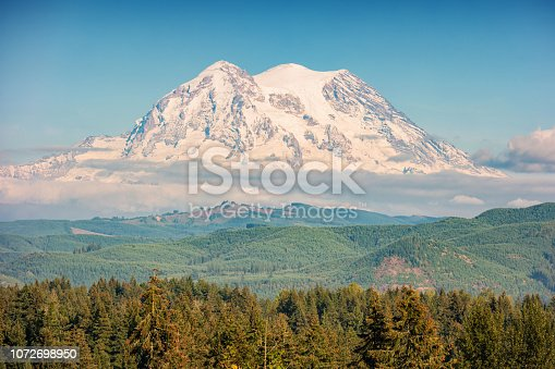 Stock photograph of snowcapped Mount Rainier in Washington, USA on a sunny day.