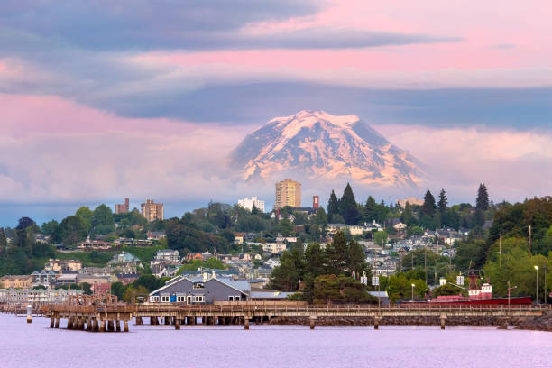 Mount Rainier over Tacoma WA waterfront during alpenglow sunset evening Mount Rainier over Tacoma Washington waterfront during alpenglow sunset evening washington state stock pictures, royalty-free photos & images