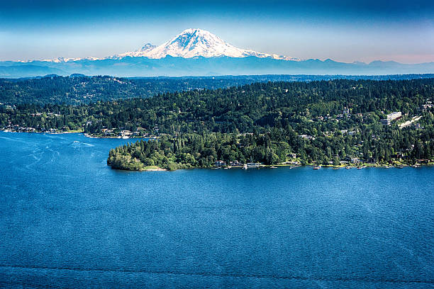 Mount Ranier View From Above Lake Washington The glacier of Mount Ranier in the Cascade Mountain Range shot from over Lake Washington just east of Seattle. pierce county washington state stock pictures, royalty-free photos & images