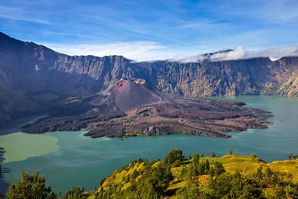 mount rinjani with the crater lake segara anak, lombok, indonesia - lombok stockfoto's en -beelden