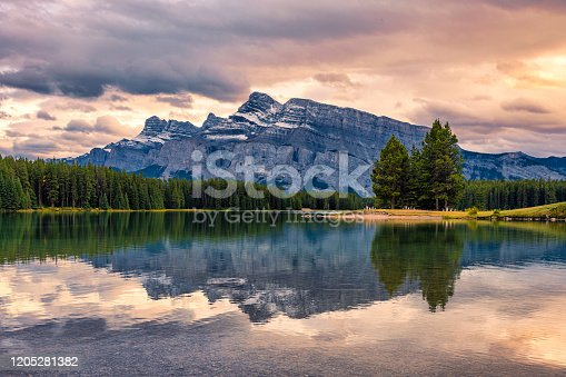 istock Mount Rundle reflection on Two Jack Lake in evening at Banff national park 1205281382
