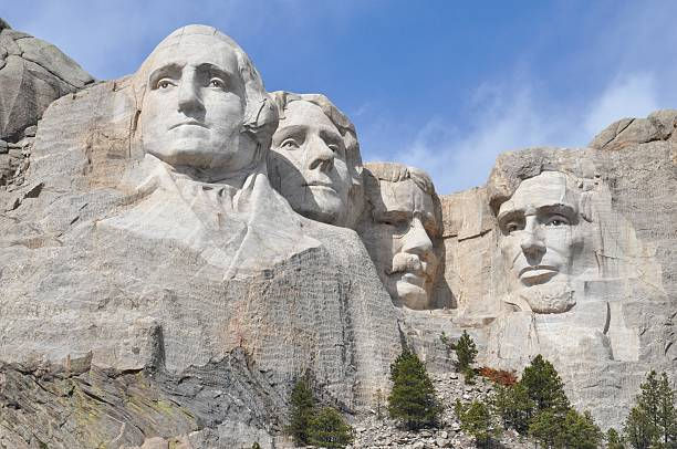 Mount Rushmore Close Up In Springtime Early morning without crowds shows a close up view of Mount Rushmore with natural colors of the mountain mount rushmore stock pictures, royalty-free photos & images