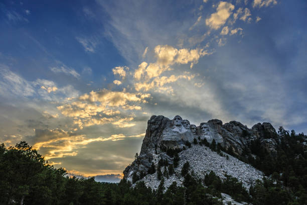 Mount Rushmore in the evening light Bright Sunset colors behind Mount Rushmore National Monument mount rushmore stock pictures, royalty-free photos & images