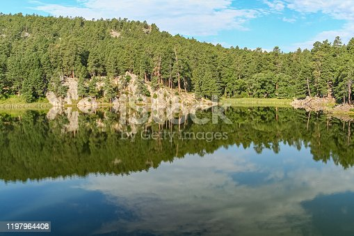 A tranquil lake on the grounds of Mount Rushmore National Memorial in Keystone, South Dakota in the heart of the Black Hills.