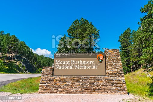 istock mount Rushmore national memorial,south dakota,usa.  07-28-17: mount Rushmore natonal memorial sign in the entrance 1224984313