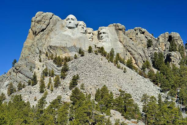 Mount Rushmore National Monument The famous Mount Rushmore National Monument in South Dakota on a sunny day. Nice travel background. mount rushmore stock pictures, royalty-free photos & images