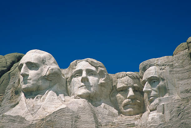 Mount Rushmore on a clear day with blue sky stock photo