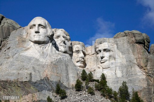 Close up view of Mount Rushmore under a blue sky