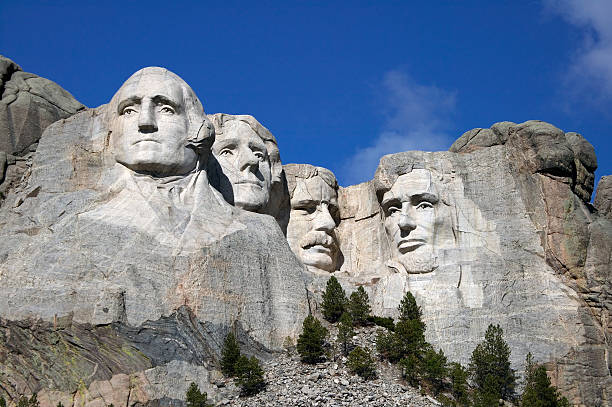 Mount Rushmore Close up view of Mount Rushmore under a blue sky mount rushmore stock pictures, royalty-free photos & images