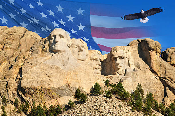 Mount Rushmore Mount Rushmore with American flag background and flying bald eagle in Black Hills, South Dakota, U.S.A. mount rushmore stock pictures, royalty-free photos & images