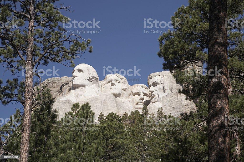 Mount Rushmore through the trees royalty-free stock photo