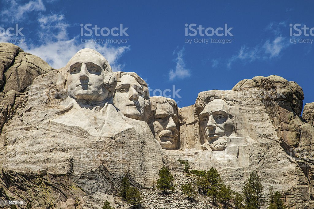 Mount Rushmore underneath a blue sky stock photo