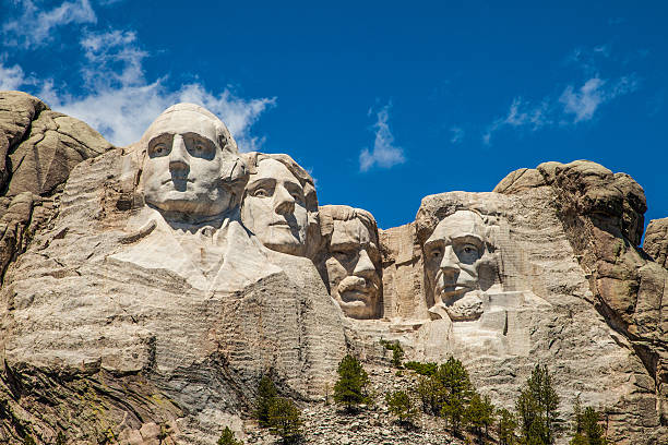 Mount Rushmore underneath a blue sky Close up view of Mount Rushmore with a blue sky mount rushmore stock pictures, royalty-free photos & images
