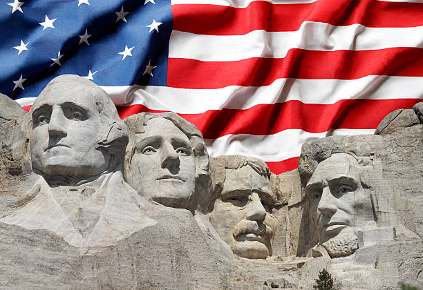 Mount Rushmore with American Flag Background Mount Rushmore with American Flag Background mount rushmore stock pictures, royalty-free photos & images