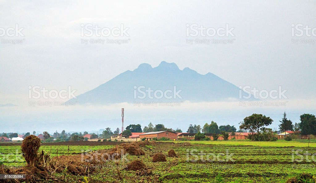 Mount Sabinyo volcano in early morning mist stock photo
