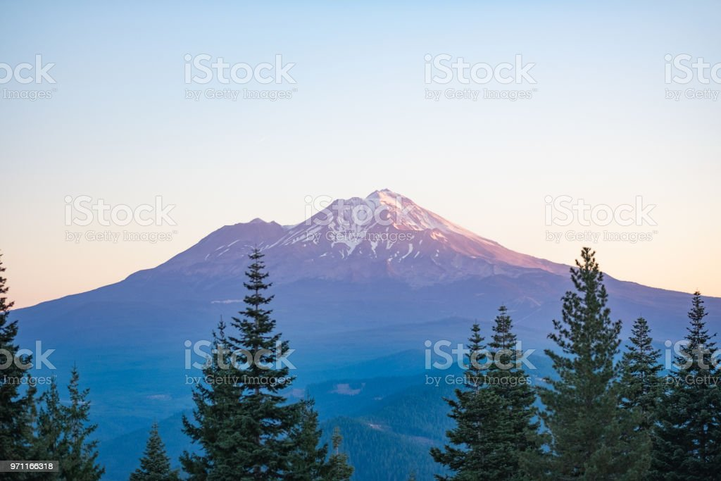 Mount Shasta with trees in front - multi-color stock photo