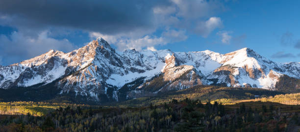 Mount Sneffels is within the Uncompahgre National Forest. An early fall snowstorm covers the peaks. stock photo