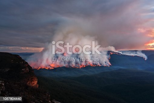istock Mount Solitary burning in Blue Mountains, Australia 1057804440