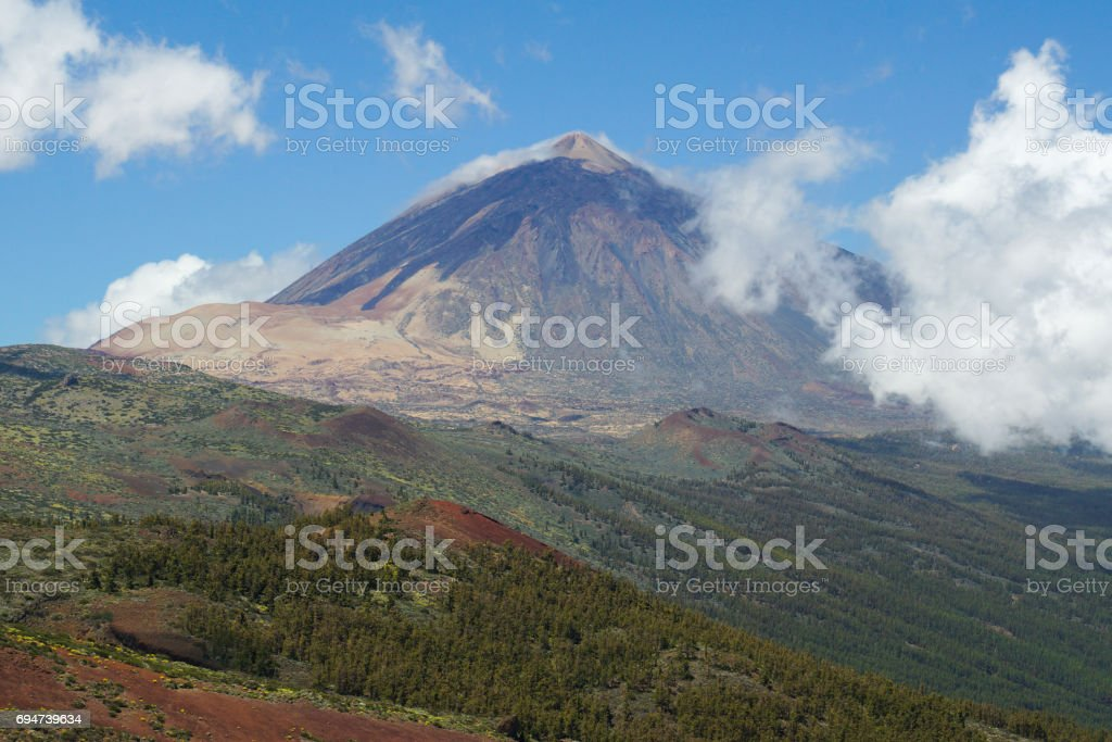 Mount Teide towers over Tenerife as low cloud is rolling in stock photo