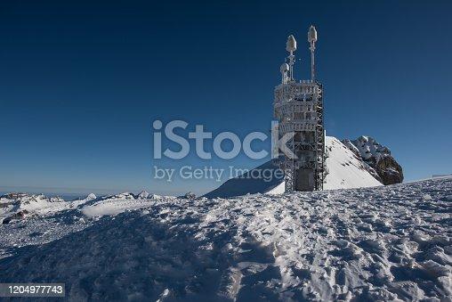 european alps landscape in winter time, mount titlis in switzerland.