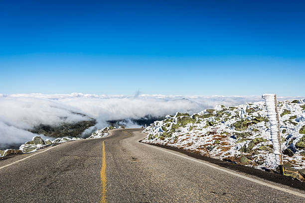 Mount Washington Auto Road, New Hampshire Mount Washington Auto Road at Mount Washington summit in New Hampshire. The sky is clear blue and the road is above the clouds. mount washington new hampshire stock pictures, royalty-free photos & images