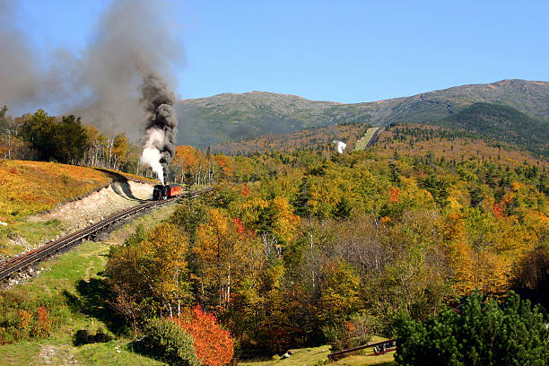 Mount Washington - Cog Railway The old cog train once again makes its climb up the side of Mount mount washington new hampshire stock pictures, royalty-free photos & images