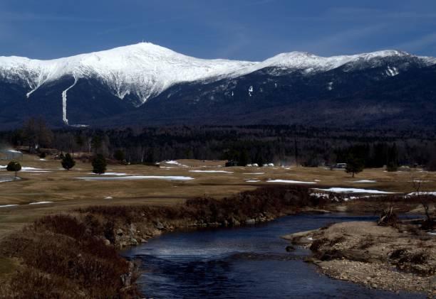Mount Washington, New Hampshire Mt. Washington, White Mountains New Hampshire.  Snow Capped Mountain in the Springtime. mount washington new hampshire stock pictures, royalty-free photos & images