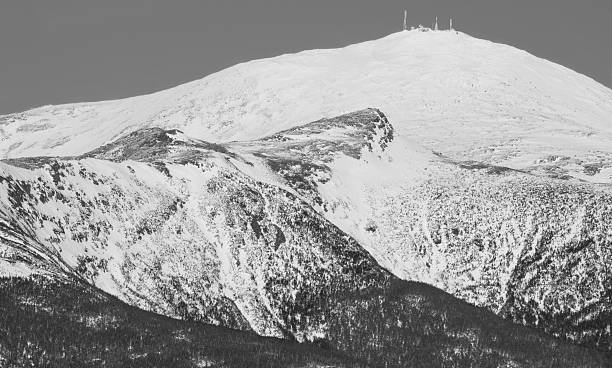 """Mount Washington Mt. Washington, NH.  Labeled as the """"worst weather in the world."""" It also holds the distinction of recording the highest surface wind speed on the planet (1934--231mph). mount washington new hampshire stock pictures, royalty-free photos & images"""