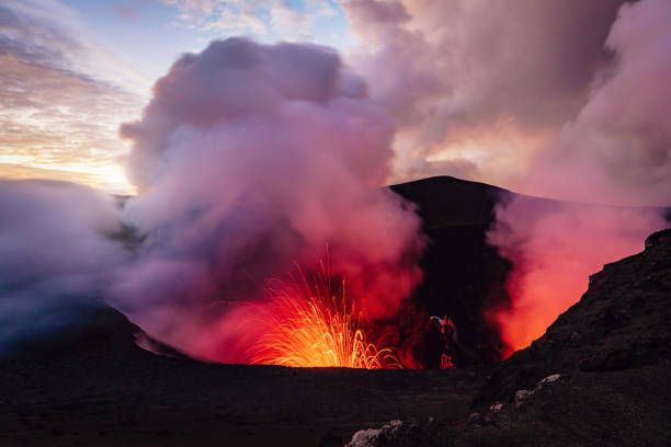 Mount Yasur Vanuatu Erupting Volcano Tanna Island Erupting Volcano Mt. Yasur, view from the crater ash top towards the erupting craterlake of the active Mount Yasur Volcano, Tanna Island, Vanuatu, Melanesia, South Pacific vanuatu stock pictures, royalty-free photos & images