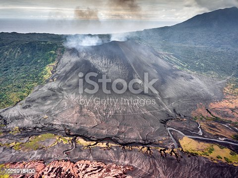Aerial View to the erupting and smoking active Mount Yasur Volcano and colorful abstact Lava Ash Plains and Landscape on Tanna Island, Vanuatu, Melanesia, South Pacific, Oceania