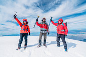 Climbers are celebrating success at the summit of the high altitude mountain in winter time in Turkey ,recorded during a climbing expedition.