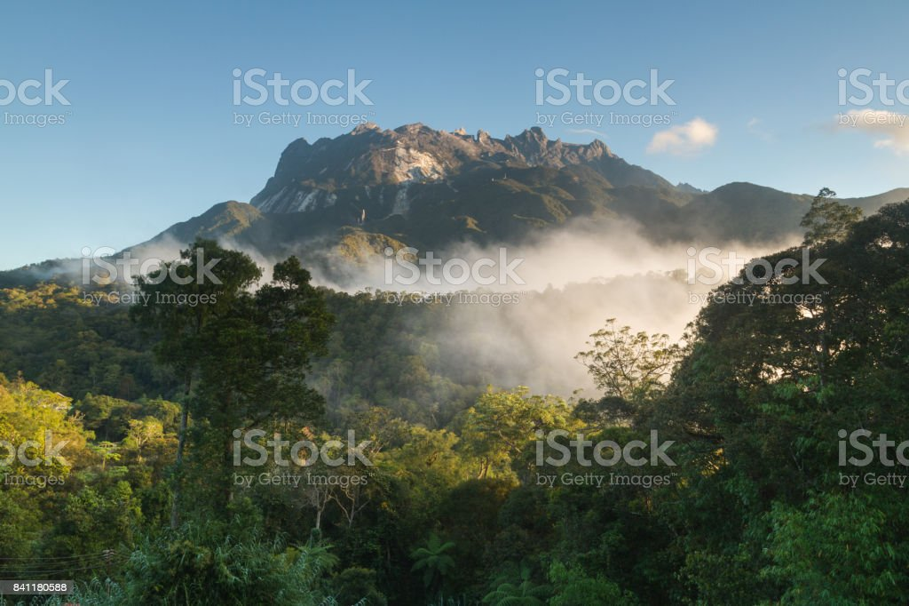 Mountain and blue sky with clouds on the jungle (Mount Kinabalu, Borneo, Malaysia) stock photo