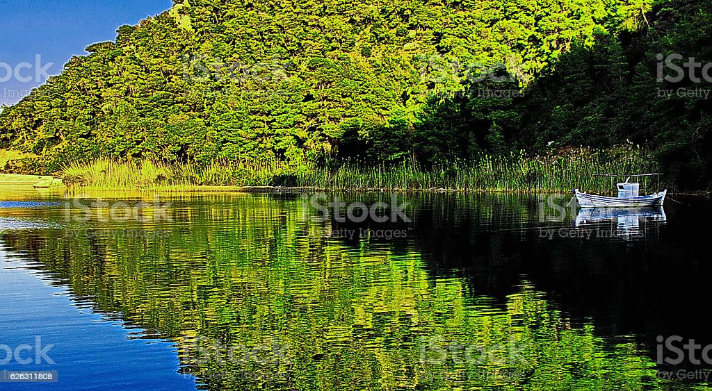 Mountain and boat reflected in water, Korinthos, Greece stock photo