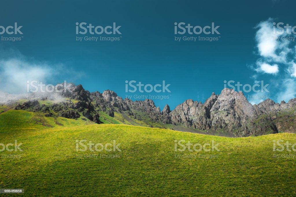 Mountain And Meadow Landscape View. Travel Outdoor Tranquil Concept stock photo