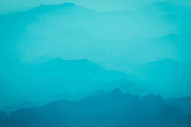 mountain and sea of clouds - low contrast stock pictures, royalty-free photos & images