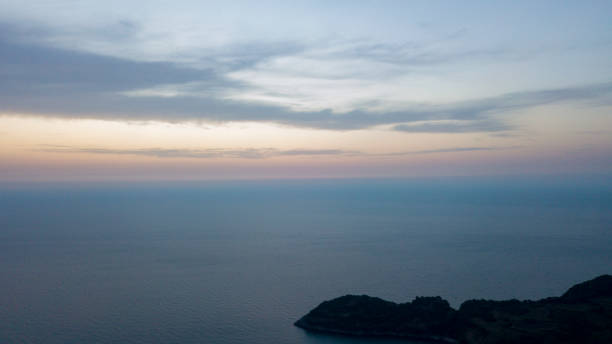 mountain and sea views. seascape drone view at sunset stock photo