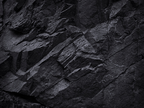 Black and white background. Black grunge texture. Contrast monochrome rocky texture.