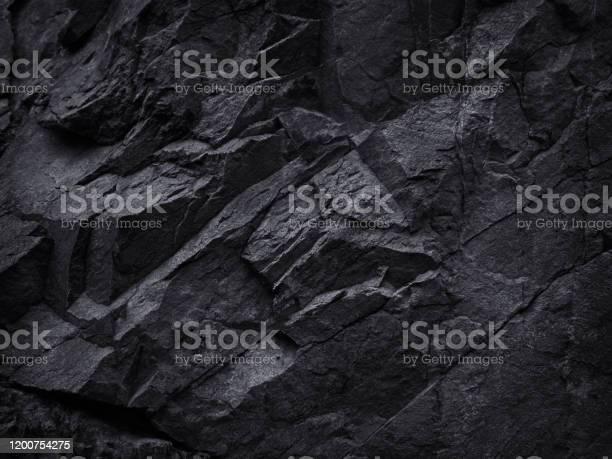 Photo of Mountain background texture. Close-up. Black rock background. Dark gray stone background.