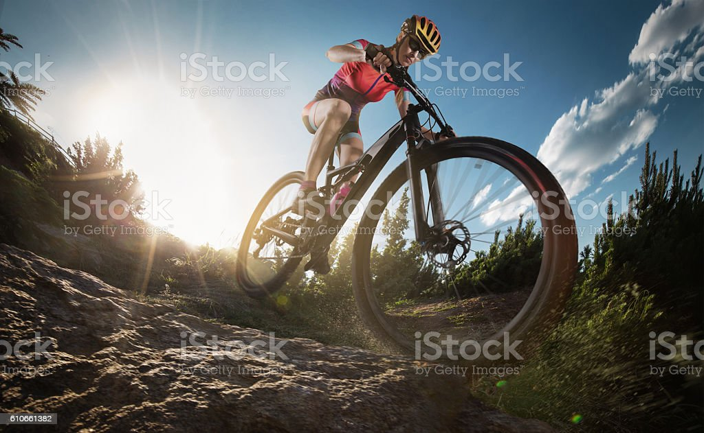 Mountain Bike cyclist riding single track. stock photo