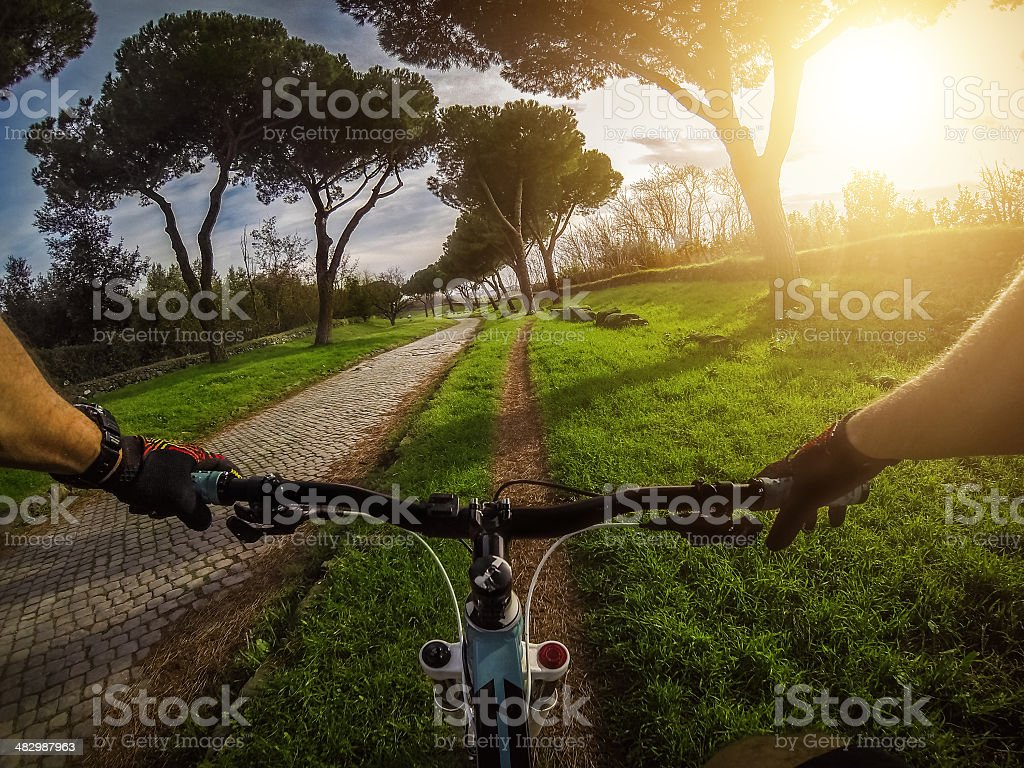 Mountain Bike on the Via Appia Antica and Aqueduct stock photo
