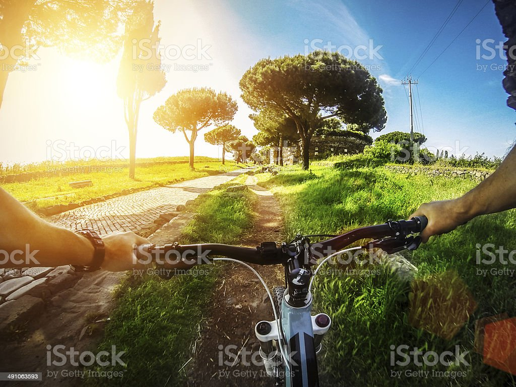 Mountain Bike on the Via Appia Antica and Aqueduct royalty-free stock photo