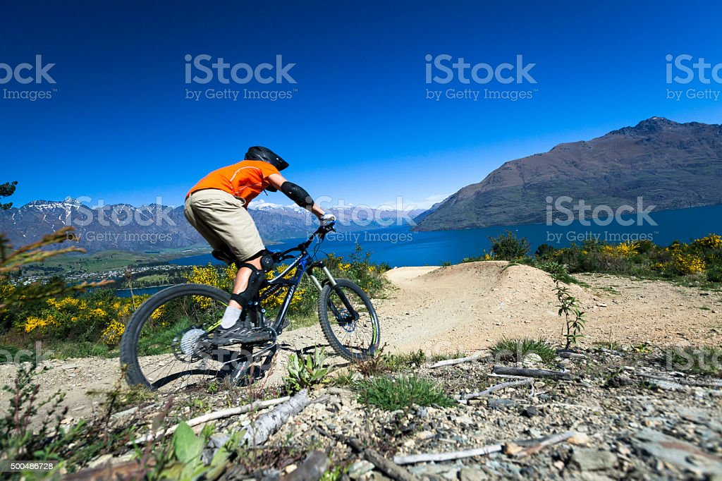 Mountain bike rider on bike path in Queenstown, New Zealand stock photo