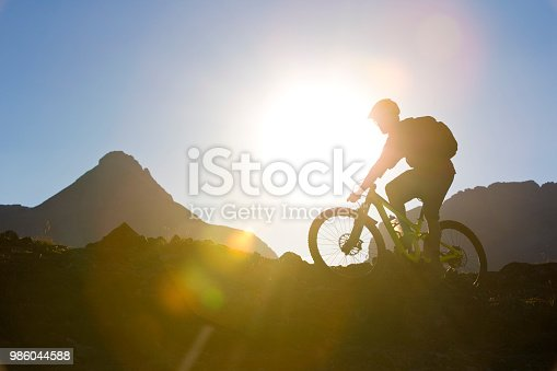 A man goes for a cross-country mountain bike ride in the Rocky Mountains of Canada.