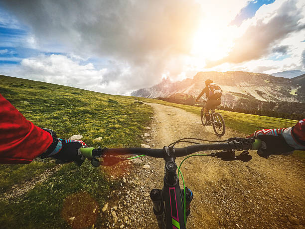 Mountain Bike: Single Trail in two DCIM100GOPROG0039423.Riding a mountain bike on the Alps: point of view camera filming. mountain biking stock pictures, royalty-free photos & images