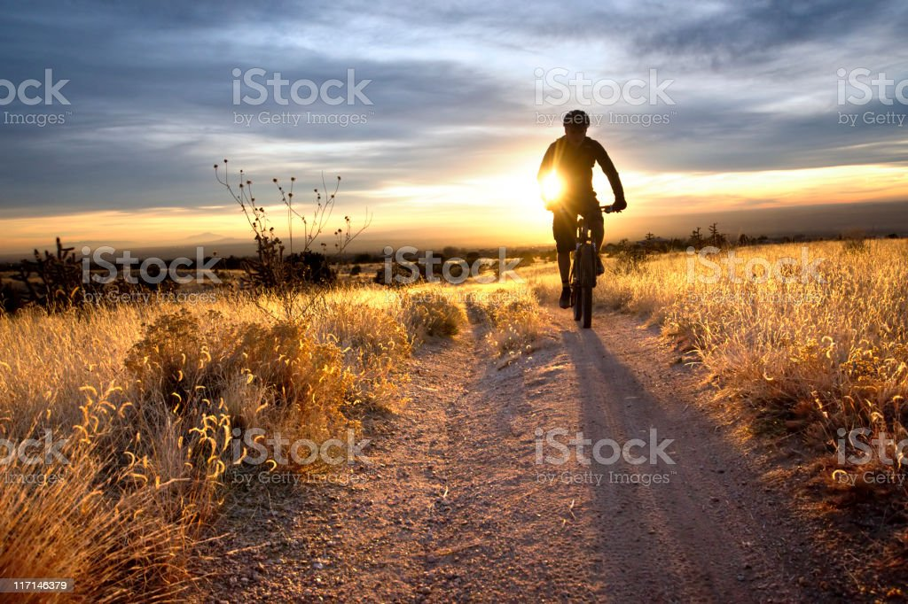 mountain bike sunset stock photo