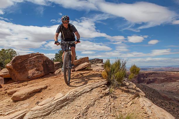Mountain biker along Poison Spider Mesa Trail in Moab Utah. stock photo