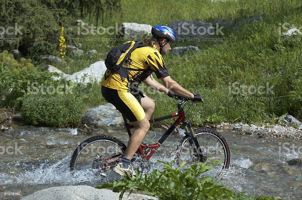Mountain biker and creek royalty-free stock photo